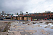 Empty lot in Digbeth looking towards the Rotunda on 14th March 2020 in Birmingham, United Kingdom. Following the destruction of the Inner Ring Road, Digbeth is now considered a district within Birmingham City Centre. As part of the Big City Plan, Digbeth is undergoing a large redevelopment scheme that will regenerate the old industrial buildings into apartments, retail premises, offices and arts facilities. There is still however much industrial activity in the south of the area.