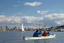 North America, United States, Washington, Seattle, couple kayaking on Lake Union near Space Needle and downtown Seattle  MR