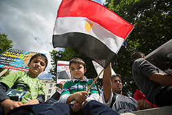 © licensed to London News Pictures. London, UK 18/08/2013. Activists from the Egyptian Forum in the United Kingdom hold a demonstration outside Downing Street, London against the ongoing troubles in Egypt on Sunday, 18 August 2013. Photo credit: Tolga Akmen/LNP