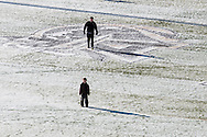 West Point, New York - A man and boy stand on the football field at Michie Stadium before the West Point Half-Marathon Fallen Comrades Run at the United States Military Academy on March 29, 2015.