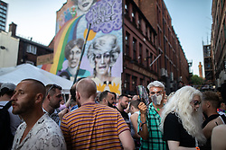 © Licensed to London News Pictures . 25/08/2019. Manchester, UK. Revellers in Manchester's Gay Village during the city's annual Gay Pride festival , which celebrates LGBTQ+ life and is the largest of its type in Europe . Photo credit: Joel Goodman/LNP