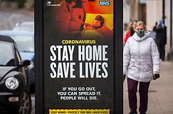 "© Licensed to London News Pictures. 11/01/2021. LONDON, UK.  A digital sign on the side of a telephone box in Northwood, north west London, displays the UK government's ""Stay At Home Save Lives"" message during the third lockdown.  Chris Whitty, England's chief medical officer, has said that the UK will endure the ""most dangerous time"" of the pandemic in the weeks before the coronavirus vaccine rollout has an impact.  To date, 2.4 million vaccinations have been administered as the number of Covid-19 related deaths have exceeded 80,000 since the start of the pandemic..  Photo credit: Stephen Chung/LNP"