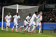 Federico Fernandez of Swansea city ® celebrates with his teammates after he scores his teams 1st goal.Barclays Premier league match, Swansea city v Aston Villa at the Liberty Stadium in Swansea, South Wales on Saturday 19th March 2016.<br /> pic by  Andrew Orchard, Andrew Orchard sports photography.