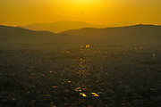 Cityscape of Athens, Greece at dusk as seen from the top of the Lycavittos hill