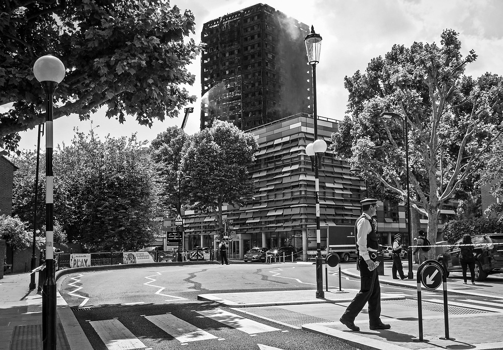 14 June 2017 taken between the hours of 14.51 - 16.24<br /> <br /> The Grenfell Tower fire occurred on 14 June 2017 at the 24-storey, 220-foot-high (67 m), Grenfell Tower block of public housing flats in North Kensington, Royal Borough of Kensington and Chelsea, West London. It caused at least 80 deaths and over 70 injuries. A definitive death toll is not expected until at least 2018. As of 5 July 2017, 21 victims had been formally identified by the Metropolitan Police. Authorities were unable to trace any surviving occupants of 23 of the flats.<br /> <br /> Emergency services received the first report of the fire at 00:54 local time. It burned for about 60 hours until finally extinguished. More than 200 firefighters and 45 fire engines from stations all over London were involved in efforts to control the fire. Many firefighters continued to fight pockets of fire on the higher floors after most of the rest of the building had been gutted. Residents of surrounding buildings were evacuated due to concerns that the tower could collapse, but the building was later determined to be structurally sound.<br /> <br /> The tower contained 129 flats. Police were unable to trace any survivors from 23 of these, and their occupants are believed to have died in the fire. Firefighters rescued 65 people. Seventy-four people were confirmed to be in six hospitals across London, and 17 of them were in a critical condition. The fire started in a fridge-freezer on the fourth floor. The growth of the fire is believed to have been accelerated by the building's exterior cladding.  ( Source Wikipedia}