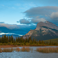 Clouds float above Mount Rundle and Vermillion Lakes in Banff National Park, Alberta, Canada.