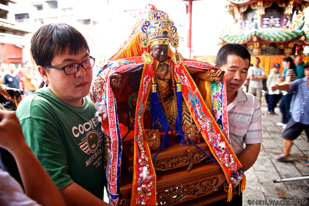 This Taoist idol is on a sort-of vacation from its usual temple home.  Occasionally, the local gods that are said to inhabit the idols go on a tour of their friend gods' temples.