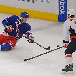 May 12, 2012: New York Rangers left wing Chris Kreider (20) dumps the puck after being dumped to the ice during first period action in game 7 of the NHL Eastern Conference Semi-finals between the Washington Capitals and New York Rangers at Madison Square Garden in New York, N.Y.