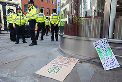 London, UK. 23rd August, 2021. Metropolitan Police officers observe environmental activists from Extinction Rebellion in the Covent Garden area on the first day of Impossible Rebellion protests. Extinction Rebellion are calling on the UK government to cease all new fossil fuel investment with immediate effect. Credit: Mark Kerrison/Alamy Live News