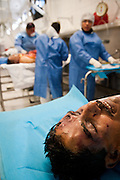 WARNING GRAPHIC CONTENT: Forensic experts perform autopsies on victims of drug shootings and assignations at the Juarez City Forensic Lab in Juarez, Mexico January 16, 2009.  An ongoing drug war has already claimed more than 40 people since the start of the year. More than 1600 people were killed in Juarez in 2008, making Juarez the most violent city in Mexico.    (Photo by Richard Ellis)