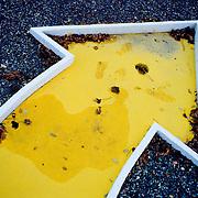 Close-up of yellow arrow sign