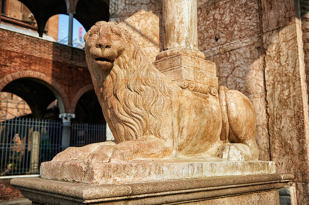 Romanesque Lion sculpture supporting columns of the Cremona Duomo Baptistry, begun 1107, Cremona, Lombardy, northern Italy .<br /> <br /> Visit our ITALY HISTORIC PLACES PHOTO COLLECTION for more   photos of Italy to download or buy as prints https://funkystock.photoshelter.com/gallery-collection/2b-Pictures-Images-of-Italy-Photos-of-Italian-Historic-Landmark-Sites/C0000qxA2zGFjd_k<br /> <br /> <br /> Visit our MEDIEVAL ART PHOTO COLLECTIONS for more   photos  to download or buy as prints https://funkystock.photoshelter.com/gallery-collection/Medieval-Middle-Ages-Art-Artefacts-Antiquities-Pictures-Images-of/C0000YpKXiAHnG2k