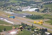 Stearman 70, Stearman N2S-3, and Stearman Cloudboy in formation over the Hood River Valley.