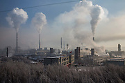 Water vapor and smoke rise from a Tonghua Iron & Steel Group Co. plant in the distance in the Erdaojiang district in Tonghua, Jilin province, China, on Wednesday, Jan. 6, 2016. The citys once-vaunted state-run steel mills have slipped inexorably into decline, weighed down by slumping global markets, a changing economy, and the burden of costs and responsibilities to the people of the town they fostered. Previous attempts to privatise the enterprise have met with stiff resistance, one such attempt resulted the mob lynching and death of a private businessman who wanted to invest and streamline the operation.