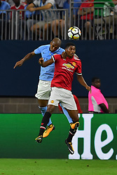 Manchester City midfielder Fernandinho (25) heads the ball away from Manchester United forward Marcus Rashford (19) during play a the International Champions Cup match between Manchester United and Manchester City at NRG Stadium in Houston, Texas