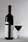 a bottle and glass of Israeli Red wine