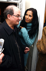 Writer SALMAN RUSHDIE and his wife PADMA LAKSHMI  at a private view of an exhibition of photographs by the late Robert Mapplethorpe curated by artist David Hockney at the Alison Jacques Gallery, 4 Clifford Street, London W1 on 13th January 2005.<br />