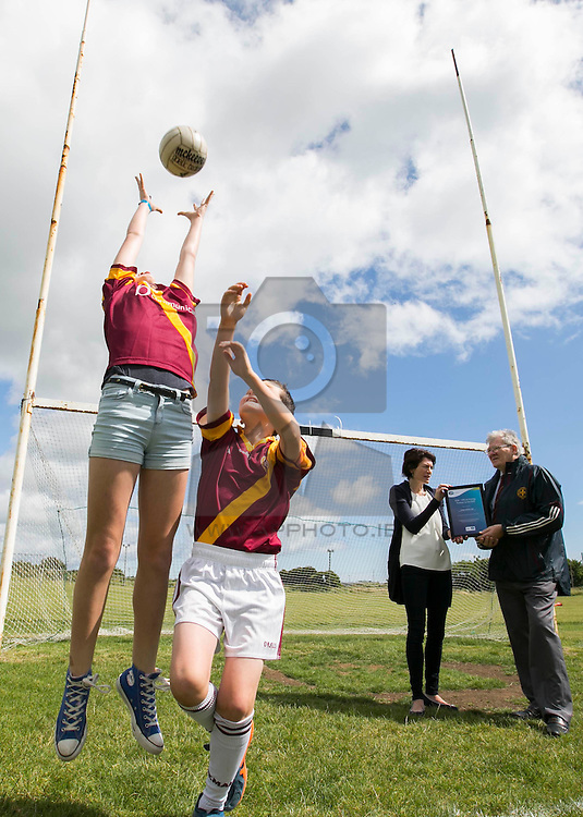 Repro Free: Dublin July 2015: ESB, Official Energy Partner to the GAA, presents St Maur's GAA Club in Rush with a cheque for €1,500. The prize is part of ESB's GAA Fund whereby ESB staff members nominated a local GAA club that is making a difference in the community. Over the coming weeks, a grand total of €30,000 will be awarded to twenty GAA clubs across the country. <br /> <br /> St Maur's GAA Club was nominated for the award by ESB staff member Geraldine Heavey.<br /> <br /> Pictured at the presentation in the club is Gerry Foley Chairman St Maur's GAA Club and Geraldine Heavey from ESB with junior club members Hannah Morley (12) and Mathew MacHale (9). Picture Andres Poveda<br /> <br /> ENDS<br /> <br /> For further information, please contact:<br /> Wilson Hartnell<br /> Rachel Solon / Sarah Gallagher<br /> rachel.solon@ogilvy.com / sarah.gallagher@ogilvy.com    <br /> 01 6690030 / 087 6245326 / 086 3517969