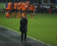 Nuno Espirito Santo, the Wolverhampton Wanderers manager looks on as his players celebrate after they score their 1st goal , scored by Diogo Silva (Jota).  The Emirates FA Cup, 3rd round replay match, Swansea city v Wolverhampton Wanderers at the Liberty Stadium in Swansea, South Wales on Wednesday 17th January 2018.<br /> pic by  Andrew Orchard, Andrew Orchard sports photography.