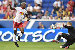 October 7, 2017 - Harrison, New Jersey, U.S - New York Red Bulls forward BRADLEY WRIGHT-PHILLIPS (99) chips Vancouver Whitecaps  goalkeeper DAVID OUSTED (1) for a goal at Red Bull Arena in Harrison New Jersey New York defeats Vancouver 3 to 0 (Credit Image: © Brooks Von Arx via ZUMA Wire)