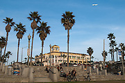 People Sitting on the Steps at the Pier in Downtown Huntington Beach on PCH