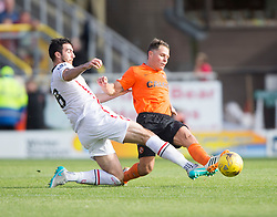 Inverness Caledonian Thistle's Ross Draper and Dundee United's John Rankin. <br /> Dundee United 1 v 1 Inverness Caledonian Thistle, SPFL Ladbrokes Premiership game played 19/9/2015 at Tannadice.