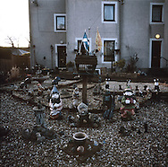 'Garden gnomes, Town Yetholm, 2014' from 'A Fine Line - Exploring Scotland's Border with England' by Colin McPherson.<br /> <br /> An army of garden gnomes gathered in a garden under the Scottish flags, possibly waiting to repel an army of English gnomes just per the border?<br /> <br /> The project was a one-year exploration of the border between the two historic nations, as seen from the Scottish side of the frontier.<br /> <br /> Colin McPherson is a photographer and visual artist based in north west England. In 2012 he was one of the founding members of Document Scotland, a collective of four Scottish documentary photographers brought together by a common vision to witness and photograph the important and diverse stories within Scotland at one of the most important times in our nation's history.<br /> <br /> 'A Fine Line' will be shown for the first time in public at Impressions Gallery, Bradford, from July 1 until September 27, 2014 to coincide with the Scottish Independence referendum.
