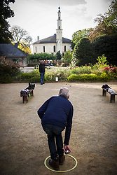 October 3, 2017 - Brussels, Bxl, Belgium - Players throw the balls paling pétanque in front of Grand Mosque in Brussels, Belgium on 03.10.2017  Belgium has banned one of the emblematic imams of the Great Mosque of Brussels, considered ''very conservative and dangerous for national security'' announced Tuesday the Secretary of State for Asylum and Migration Theo Francken.  by Wiktor Dabkowski (Credit Image: © Wiktor Dabkowski via ZUMA Wire)