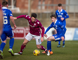 06MAR21Arbroath's Michael McKenna and Queen of the South's James Maxwell. Arbroath 2 v 4 Queen of the South, Scottish Championship played 6/3/2021 at Arbroath's home ground, Gayfield Park.