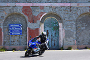 Motorcyclist on Suzuki R GSX motorbikes drives The Stelvio Pass, Passo dello Stelvio, Stilfser Joch, to Bormio, Italy