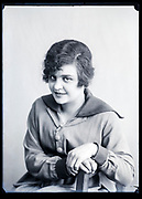 happy young adult woman with big wide open eyes looking at the camera circa 1920s