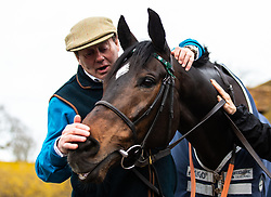 Nicky Henderson and Altior poses for the media during the visit to Nicky Henderson's yard at Seven Barrows, Lambourn.