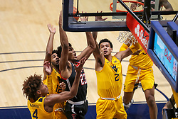 Jan 25, 2021; Morgantown, West Virginia, USA; Texas Tech Red Raiders guard Chibuzo Agbo (23) shoots in the middle of many West Virginia Mountaineers defenders during the first half at WVU Coliseum. Mandatory Credit: Ben Queen-USA TODAY Sports