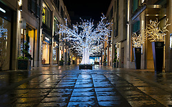 Edinburgh, Scotland, UK. 19 December 2020.  Views of streets and shops in Edinburgh City Centre on evening that Scottish Government announced the highest level 4 lockdown will be enforced from Boxing Day in Scotland.  Pic;  Multrees Walk fashion shopping arcade is deserted. Iain Masterton/Alamy Live News