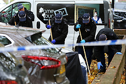 © Licensed to London News Pictures. 12/10/2020. London, UK. Police search team carrying out the search within the crime scene in Homerton in Hackney, north London following triple shooting. Officers were called at 22:48hrs on Sunday, 11 October, to reports of a shooting on Homerton High Road in Hackney, and found three people with gunshot injuries. Two men, aged 60 and 32, were taken to hospital with non life-threatening/life-changing injuries. A third man, aged 24, was taken to hospital and remainsin a life-threatening condition. Photo credit: Dinendra Haria/LNP