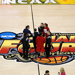 Apr 9, 2013; New Orleans, LA, USA; Connecticut Huskies and Louisville Cardinals players shake hands for the captains meeting before the championship game in the 2013 NCAA womens Final Four at the New Orleans Arena. Mandatory Credit: Derick E. Hingle-USA TODAY Sports