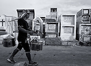 Seller of famous BALUT - a delicacy that Filipinos are so fond - a fertilized duck egg in which the embryo is already partially formed, runs the cemetery playing your horn to draw customers.