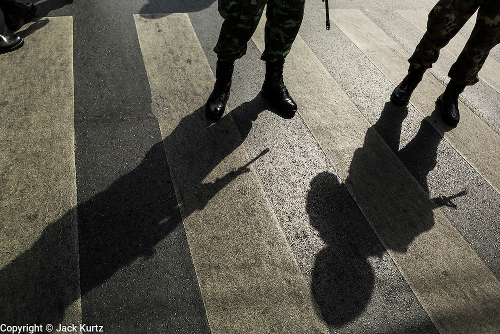 23 MAY 2014 - BANGKOK, THAILAND: A silhouette of Thai soldiers on duty in Bangkok. The Thai military seized power in a coup Thursday evening. They suspended the constitution and ended civilian rule. This is the 2nd coup in Thailand since 2006 and at least the 12th since 1932. The army has ordered both anti-government protestors in Bangkok and pro-government protestors in the suburbs to go home and arrested leaders of both groups.    PHOTO BY JACK KURTZ