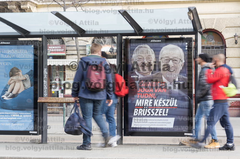 """Billboard bearing portraits of European Commission chief Jean-Claude Juncker (R) and Hungarian-born US investor and philanthropist George Soros and a slogan reading """"You too have a right to know what Brussels is preparing"""". Hungary launched a new anti-immigration media campaign on February 19, 2019 in which it accused George Soros and Jean-Claude Juncker of allegedly supporting illegal migration, but which Brussels immediately dismissed as """"fake news""""."""