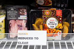 "© Licensed to London News Pictures. 19/12/2014. London, UK. Reduced to clear items costing 10p in the Community Shop. The Community Shop opened this week in Gipsy Hill, South London and is a ""social supermarket"", which sells heavily-discounted surplus food that would otherwise be thrown away. Food is received from retail brands such as Marks & Spencer, Asda, Tesco, Innocent and Muller and many more. The shop works on a membership basis only, serving residents who are on income support and aimed at people who are in work, but low waged and for those working hard to find a job. Photo credit : Vickie Flores/LNP"