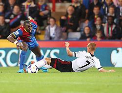 Fulham's Steve Sidwell fould Crystal Palace's Yannick Bolasie that leads to Crystal Palace's first goal - Photo mandatory by-line: Robin White/JMP - Tel: Mobile: 07966 386802 21/10/2013 - SPORT - FOOTBALL - Selhurst Park - London - Crystal Palace V Fulham - Barclays Premier League