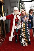 Koningin Maxima is aanwezig bij de BZT Kerstshow in Carre Amsterdam. De BZT Band XXL is compleet! Tien muzikale groepen, met elk een eigen 'sound', treden aanstaande op in een vol Carré op het Kerst Muziekgala 2016 als onderdeel van Meer muziek in de klas.<br /> <br /> Queen Maxima attends the BZT Christmas Show in Amsterdam Carre. The BZT Band XXL is complete! Ten musical groups, each with its own 'sound', stairs leading into a full Carré in Christmas music gala 2016 as part of more music in class.<br /> <br /> Op de foto / On the photo: Koningin Maxima en de Kerstman  / Queen Maxima and Santa Claus