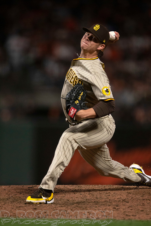 Oct 1, 2021; San Francisco, California, USA; San Diego Padres pitcher Emilio Pagán (14) delivers a pitch against the San Francisco Giants during the eighth inning at Oracle Park. Mandatory Credit: D. Ross Cameron-USA TODAY Sports