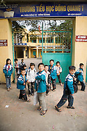Kids out of school in the craft village of Dong Ky, specialized in wood furnitures manufacture. Vietnam, Asia