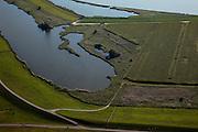 Nederland, Friesland, Gemeente Lemsterland, 08-09-2009; Onder in beeld de  slaperdijk van de Uitheiing polder, de vroegere zeedijk van de Zuiderzee / IJsselmeer boven in beeld..Bottom of the image sleeper dike (inner dike)of Uitheiing polder, top of the image the old seawall of the former Zuiderzee / IJsselmeerLuchtfoto (toeslag); aerial photo (additional fee required); .foto Siebe Swart / photo Siebe Swart