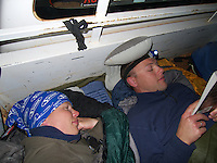 Couple camping in the back of a truck