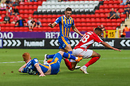 Shrewsbury Town defender Ryan Haynes (3) performs a tackle on Charlton Athletic forward Karlan Ahearne-Grant (18) during the EFL Sky Bet League 1 match between Charlton Athletic and Shrewsbury Town at The Valley, London, England on 11 August 2018.