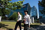 People passing the shopping malls and offices in Zhongguancun or Zhong Guan Cun, a technology hub in Haidian District, Beijing, China. It is situated in the northwestern part of Beijing city. Zhongguancun is very well known in China, and is often referred to as China's Silicon Valley. This is Beijing's computer district with numerous tech companies offices situated here amongst the many malls which sell electronics and electrons equipment of all kinds. The tech park started as a small office where two decades ago some students from a nearby university decided that computer equipment may be a thing of the future so set up a small company. It has expanded in this time to  cover many square kilometres.
