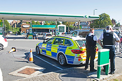 © Licensed to London News Pictures 24/09/2021.<br /> Mottingham, UK, Police watch on. No petrol or Diesel at this BP station in Mottingham Village, South East London. Chaos at the forecourts as people start to panic buy petrol. BP has started to ration petrol and diesel due to a shortage of truckers. Photo credit:Grant Falvey/LNP