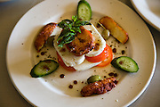 A plate of caprese salad at a restaurant in Los Angeles, California.